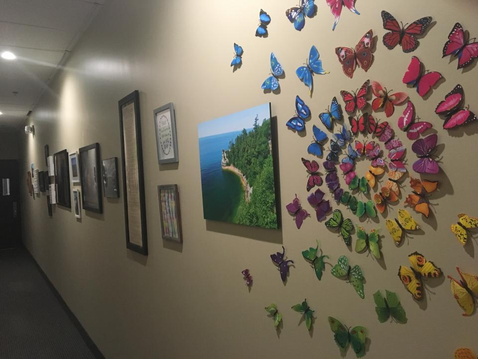 Opposite our values board is a wall of art provided by our employees.