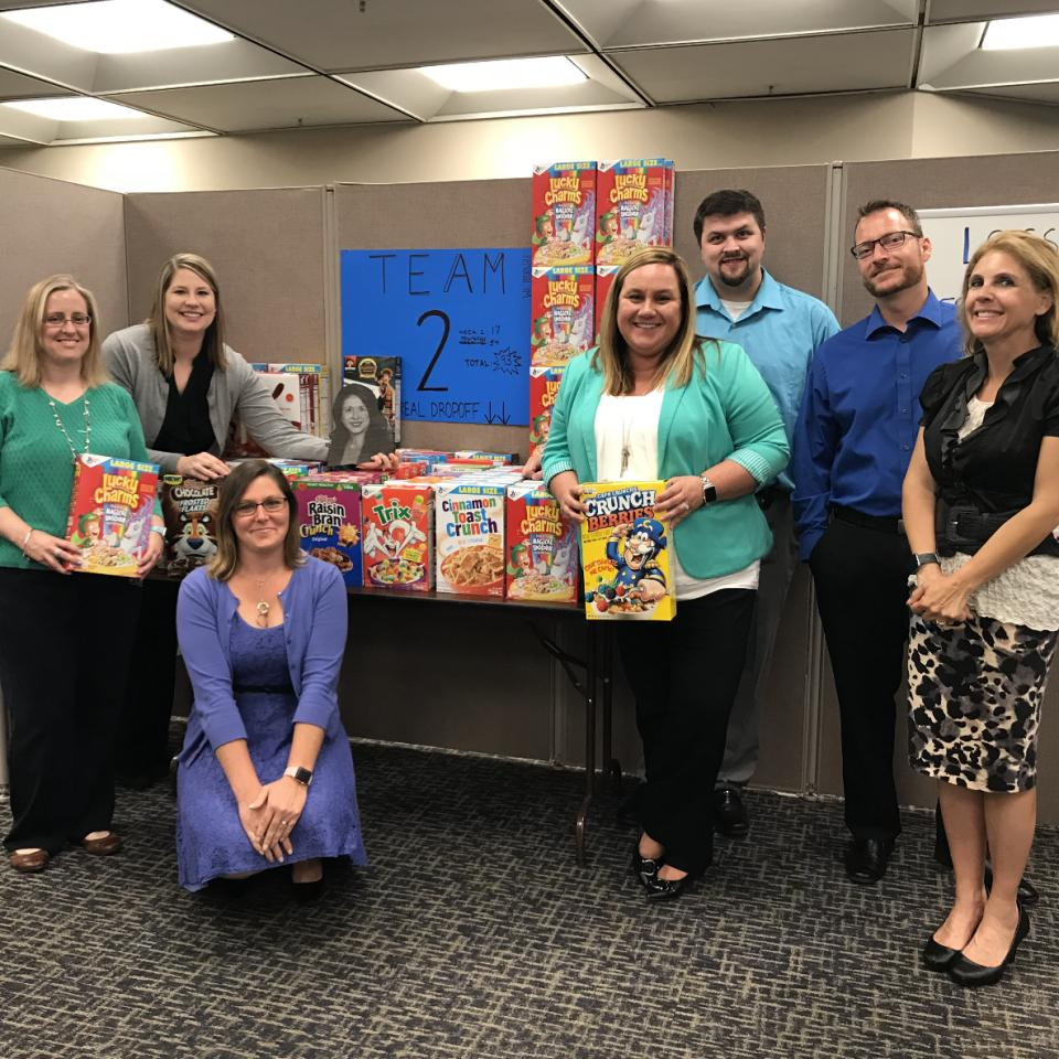 Lansing associates donate to a cereal drive for a local charity organization.