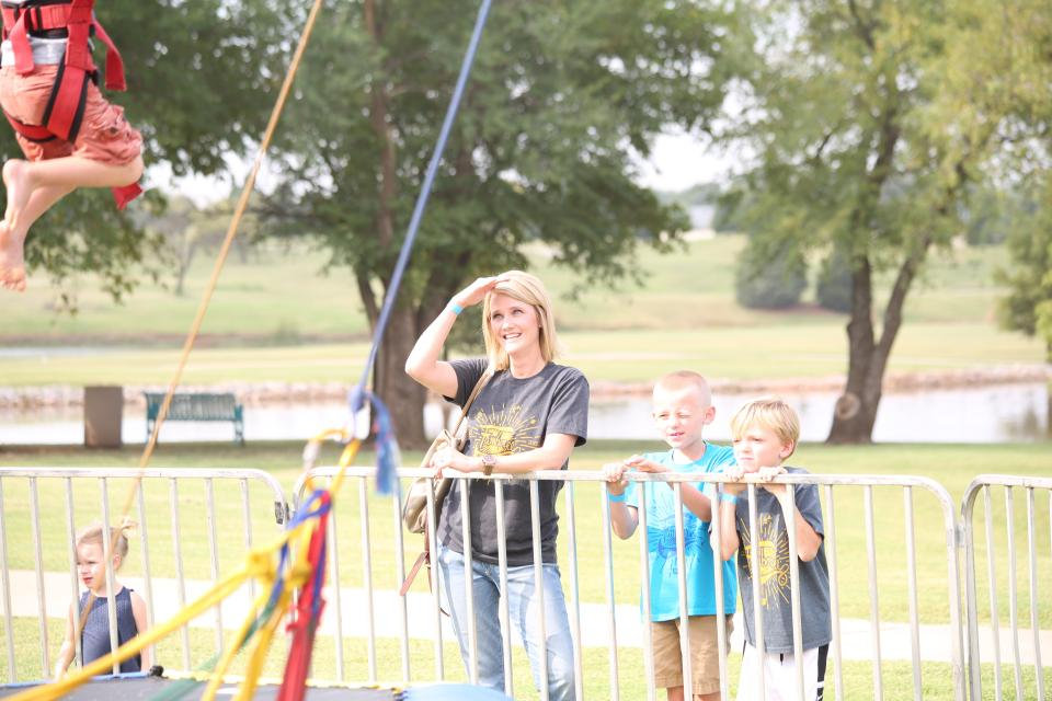 Jessica Sanders enjoys time with her family at our annual Famboree Family and Charity Event