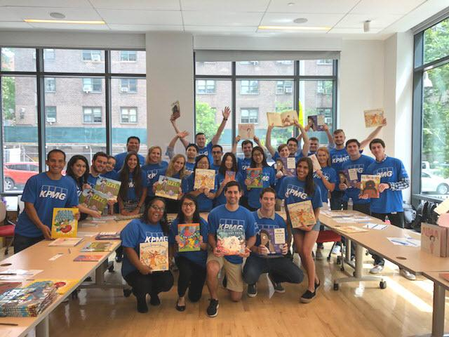 A team of KPMGers hosting a book fair for students as part of KPMG's Family for Literacy program.