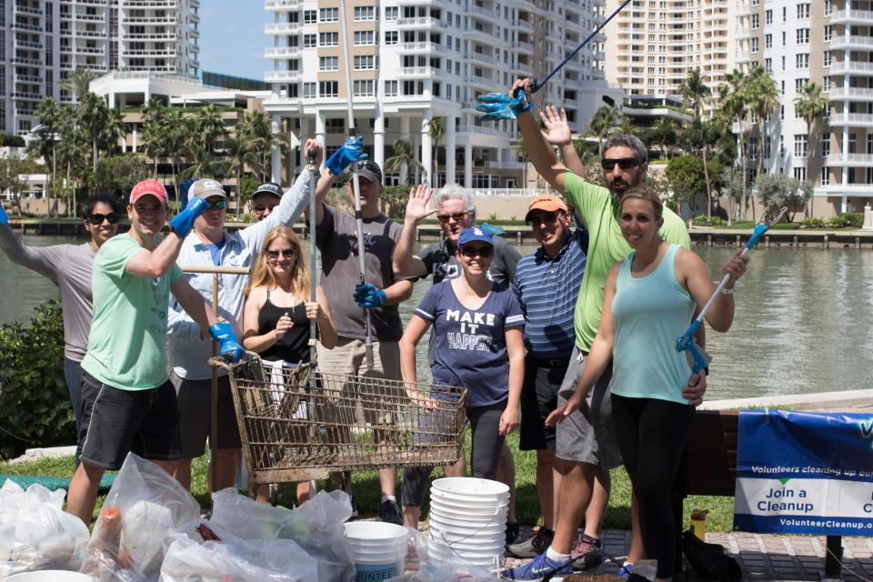 At their annual meeting, Kimley-Horn shareholders clean up water in Miami.