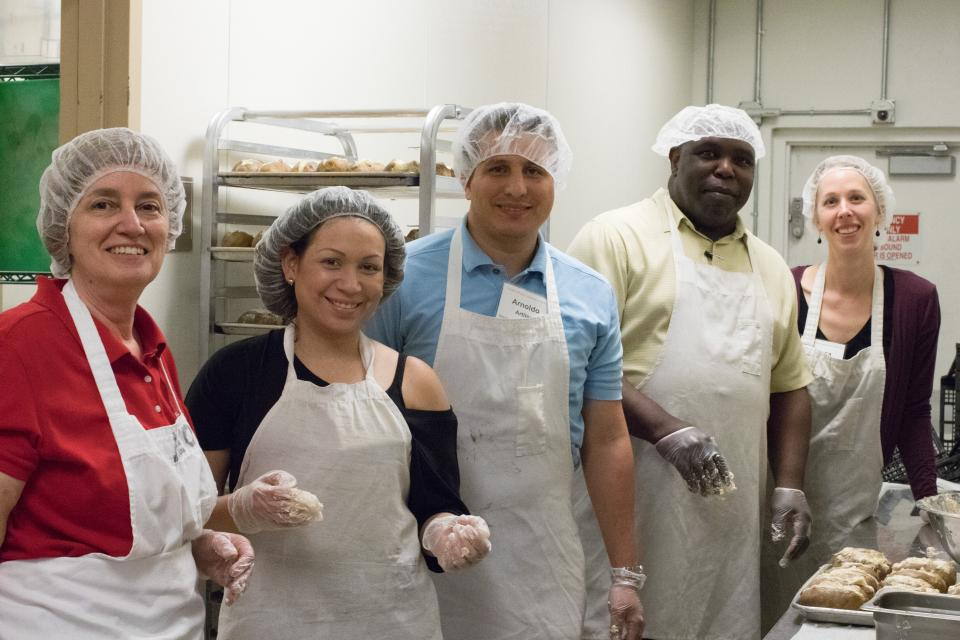 At their annual meeting, Kimley-Horn shareholders serve meals to community members in Miami.