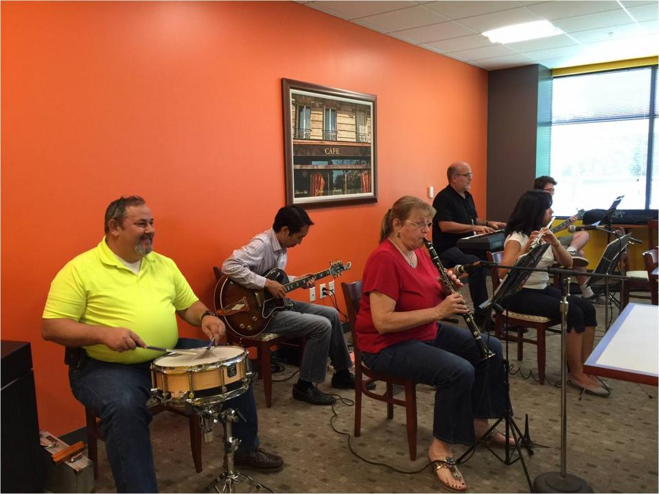 Employee band jamming in the lunch room