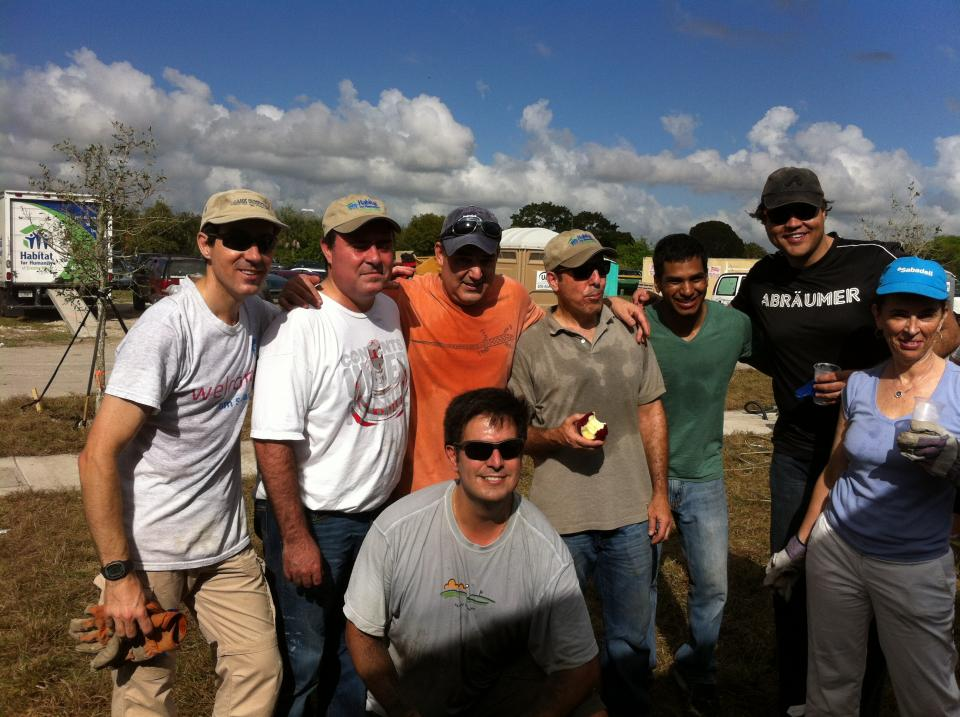 Team Sabadell helping build homes at a Habitat for Humanity event
