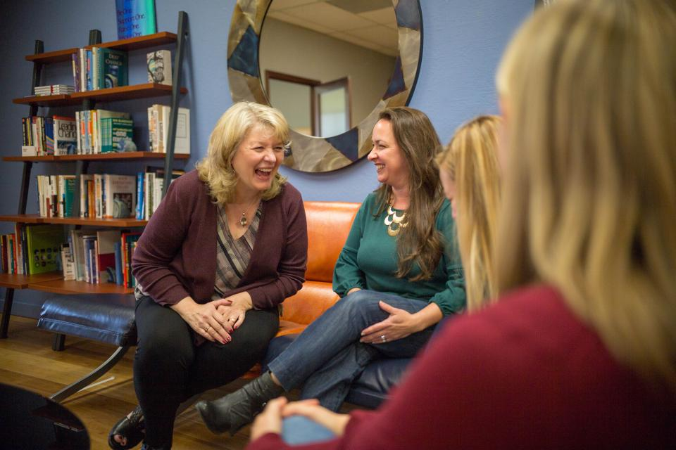 Blue Beyond Founder & CEO, Cheryl Fields Tyler, chats with Erin Wilgus, Caitlin Corda, and Mariah Cherniss in the lobby of our Castro Valley Headquarters.