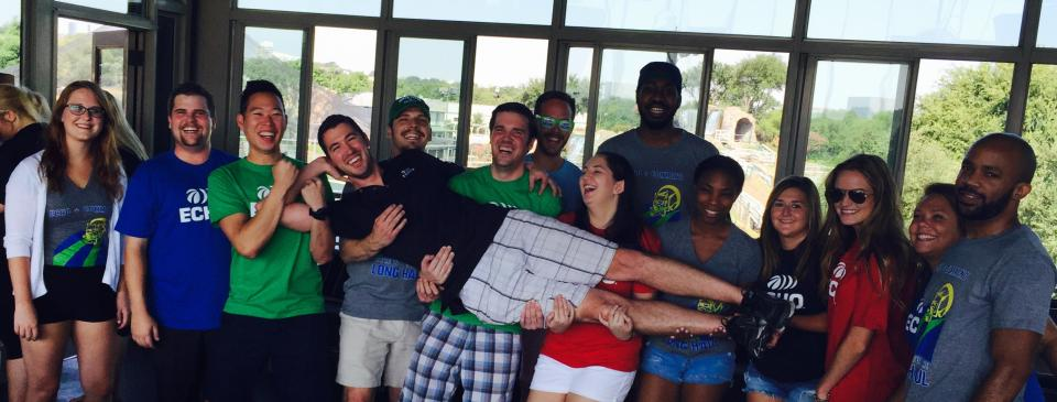 We Carry the Load Together, literally! Echo Dallas trainees hold up their trainer, Luke, at a company outing.