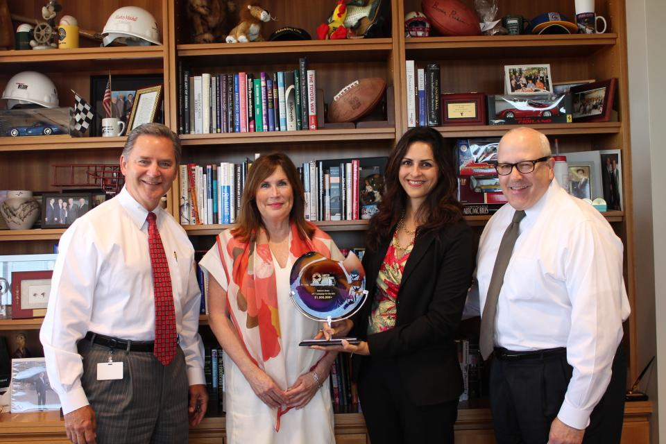 Edward Jones Managing Partner Jim Weddle, left, accepts an award from The Arts and Education Council for a $1 million commitment. Also pictured, Cynthia A. Prost, A&E president/CEO, Kit Sundararaman, partner campaign chair, and Bob Ciapciak, Managing Partner's office.