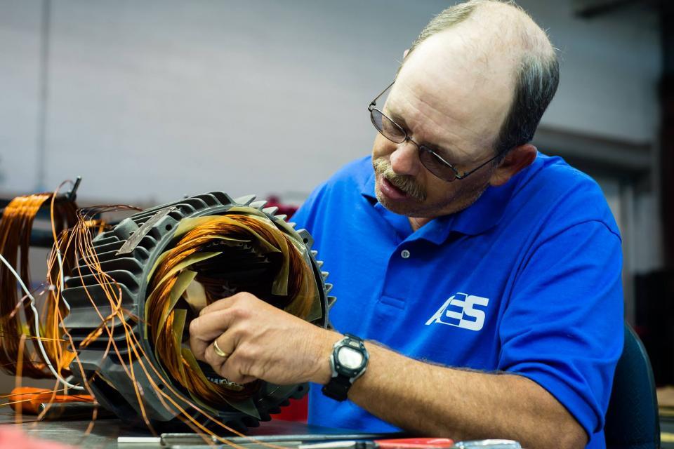 Mechanical Repair Technician rewinds motor.