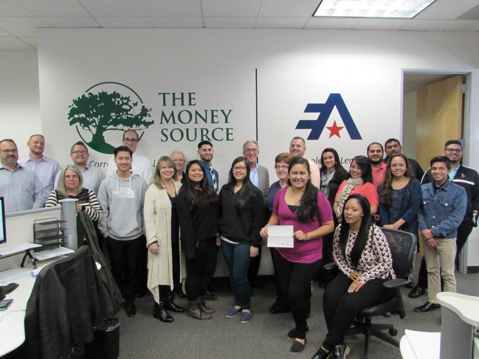We gathered for a quick photo to celebrate the money we raised during Thanksgiving to donate to our local food bank.