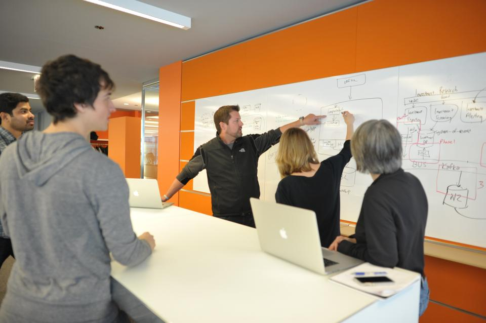 Employees brainstorming ideas in the office