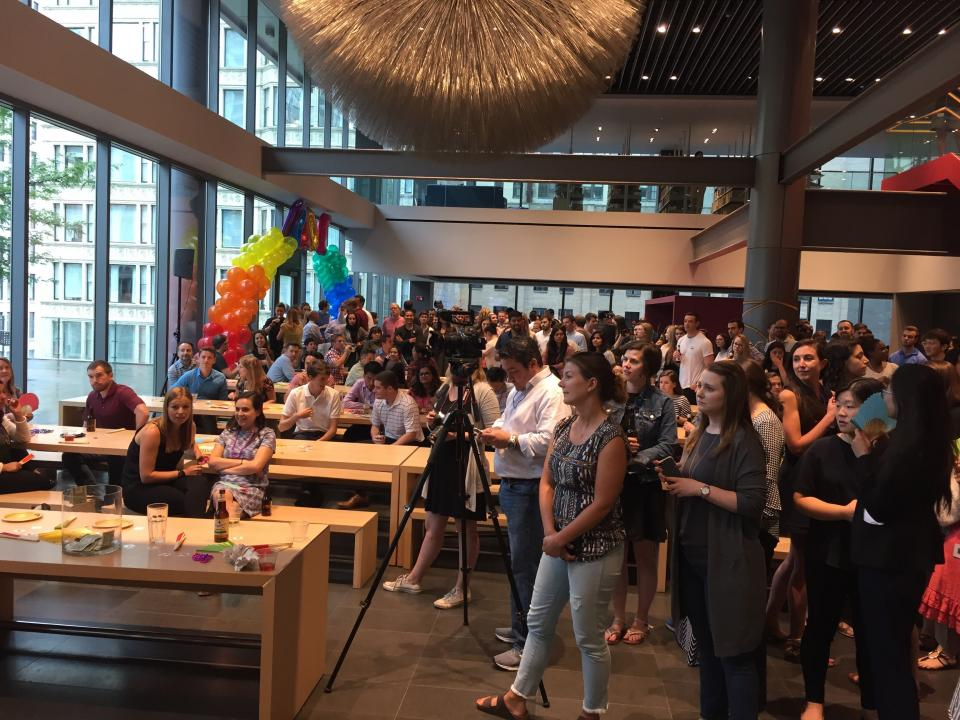 Employees watching the drag queen performance with delight at our 2017 Out@Morningstar Pride Patio Party.
