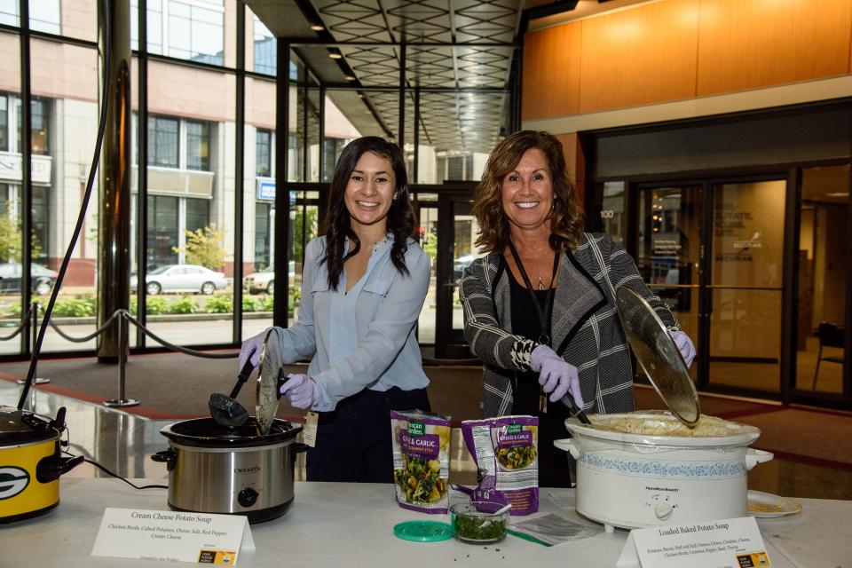 "Securian associates get creative to help reach the company's United Way fundraising goal, hosting events such as the uniquely Minnesotan Crocktober Fest. A collectible mug is sold, and associates sample crockpot ""hot dishes"" brought in by fellow associates."