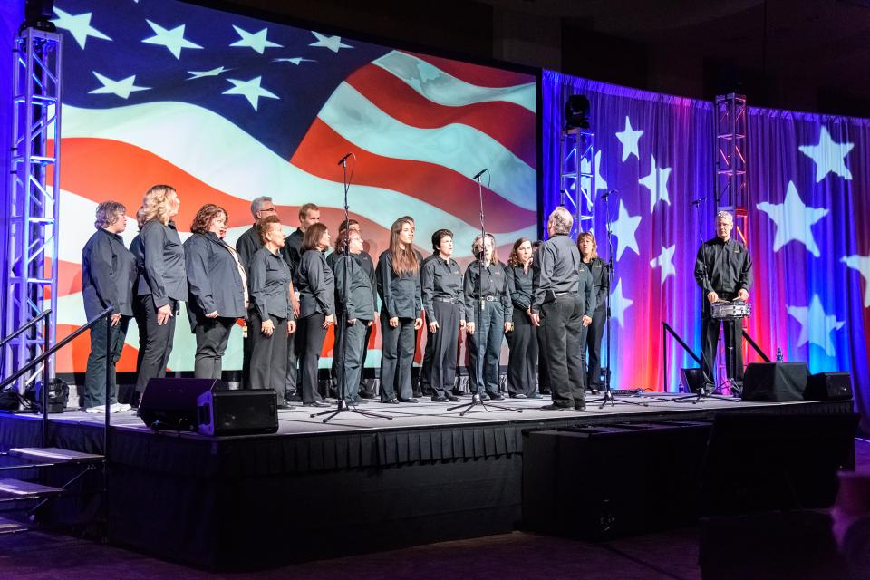 Securian subsidizes a variety of organized activities for its associates, from sports teams and leagues to the Securian Sound choir, pictured here singing the National Anthem at Securian's annual All-Company Meeting.
