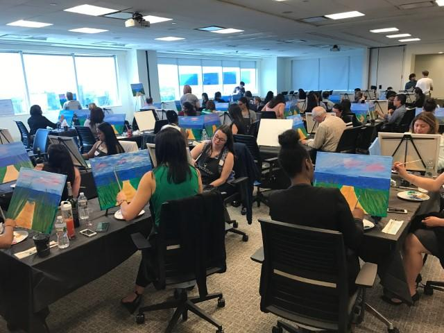 A Paint It Forward event at Verisk corporate headquarters raised funds for Dress for Success