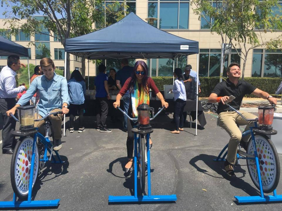 Employees blow off steam with blender bikes.