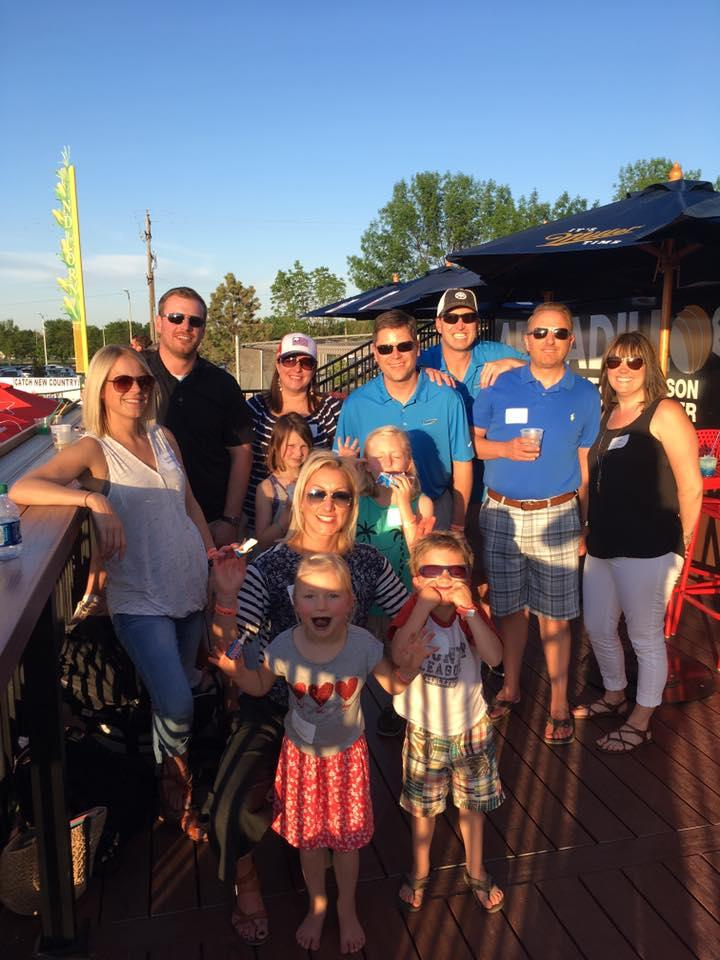 The Marco Fargo team enjoying a summertime RedHawks baseball game