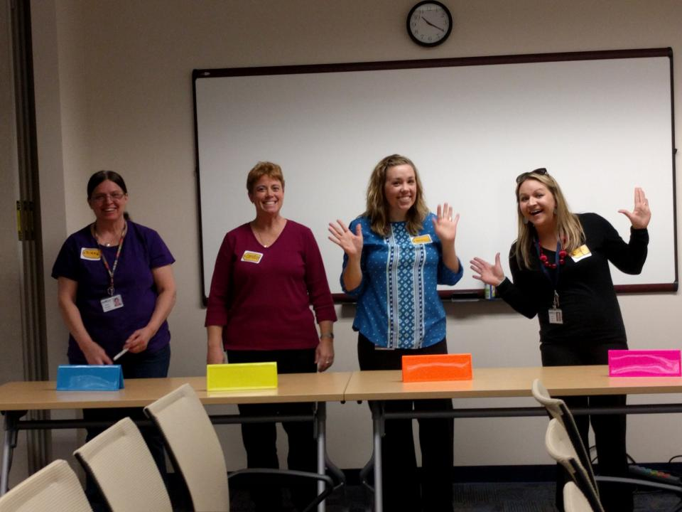 Associates enjoying 'The Price is Right'-style game to learn about healthy eating