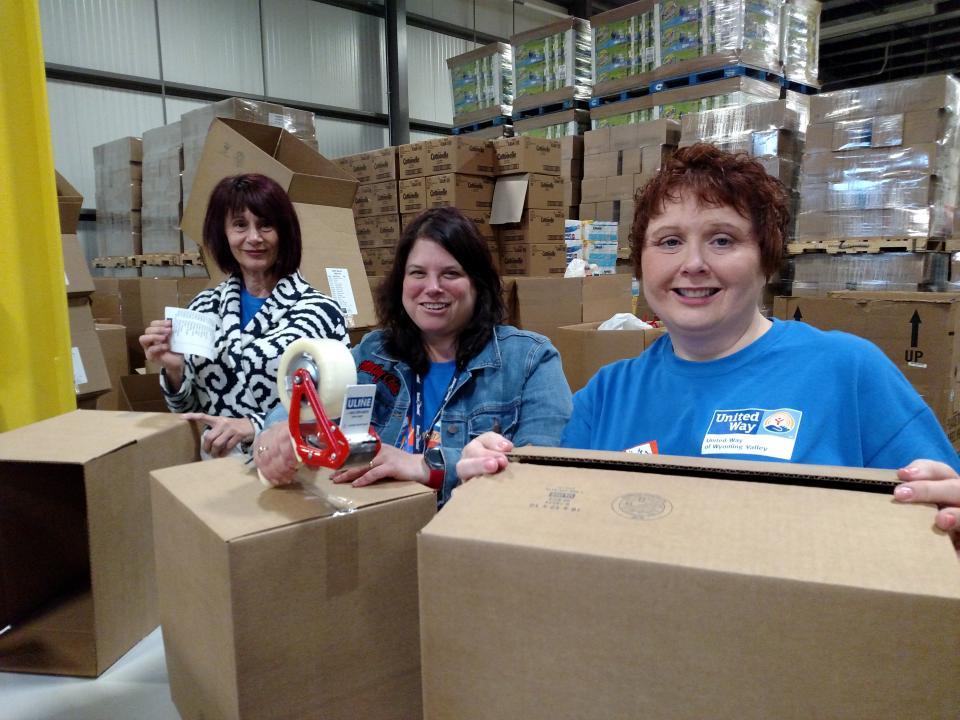 Associates volunteering at the local Food Bank