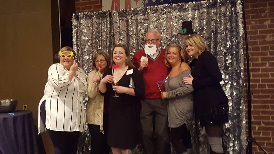 Fun photo booth at our annual Holiday party.