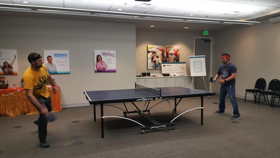 Ping Pong Tournament - At Evergreen Home Loans, one of our core convictions is FUN! One of the ways that comes to life is an all-day ping-pong tournament that features fierce competition, food and music at our Home Office.