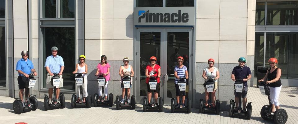 Emphasizing the human element over material gifts, Pinnacle associates celebrate milestone anniversaries with lunch and a fun afternoon outing like this Segway tour of downtown Nashville.