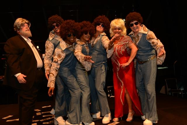 Pinnacle's fun and costume-rich anniversary party is always full of creativity, like this one where associates as Kenny Rogers and Dolly Parton bring The Jackson Five to the stage in a Music City-themed event.