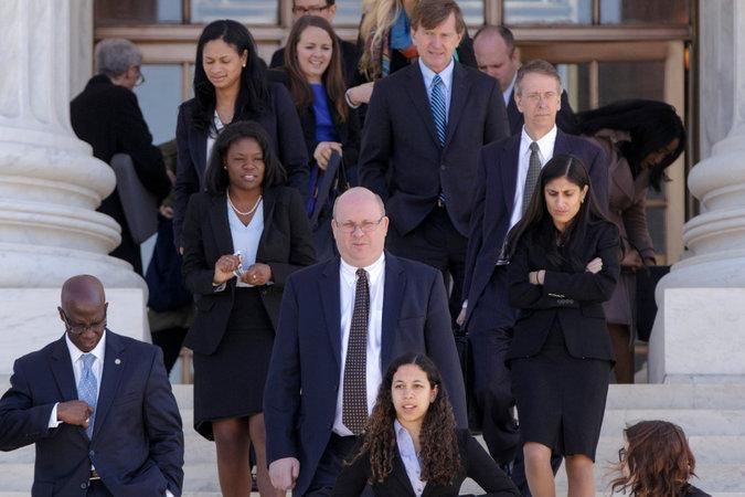 A New York Times photo captures the firm's Political Law team leaving the courthouse after a winning oral argument in a voting rights case before the United States Supreme Court.
