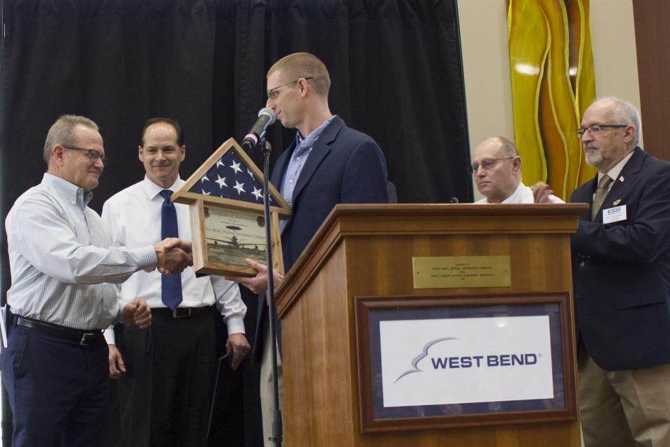 West Bend receives flag that was flown on a plane to Iraq and Syria to honor West Bend Mutual Insurance Co. Flag is being presented to our CEO/President in a special ceremony by one of our Regional Sales Managers.