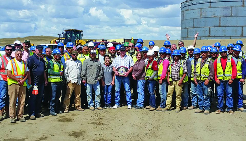 Safety team winners proudly showing off their WWF-style belt