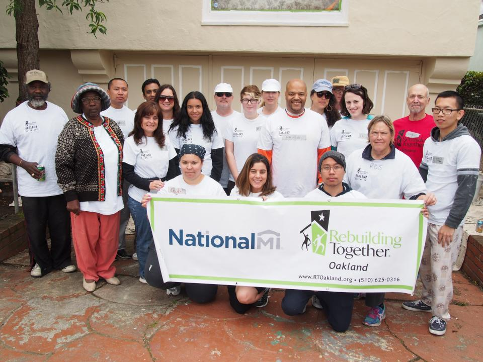 National MI employees volunteering with Rebuilding Together