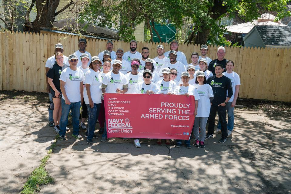 Navy federal employees volunteer for Rebuilding Together.