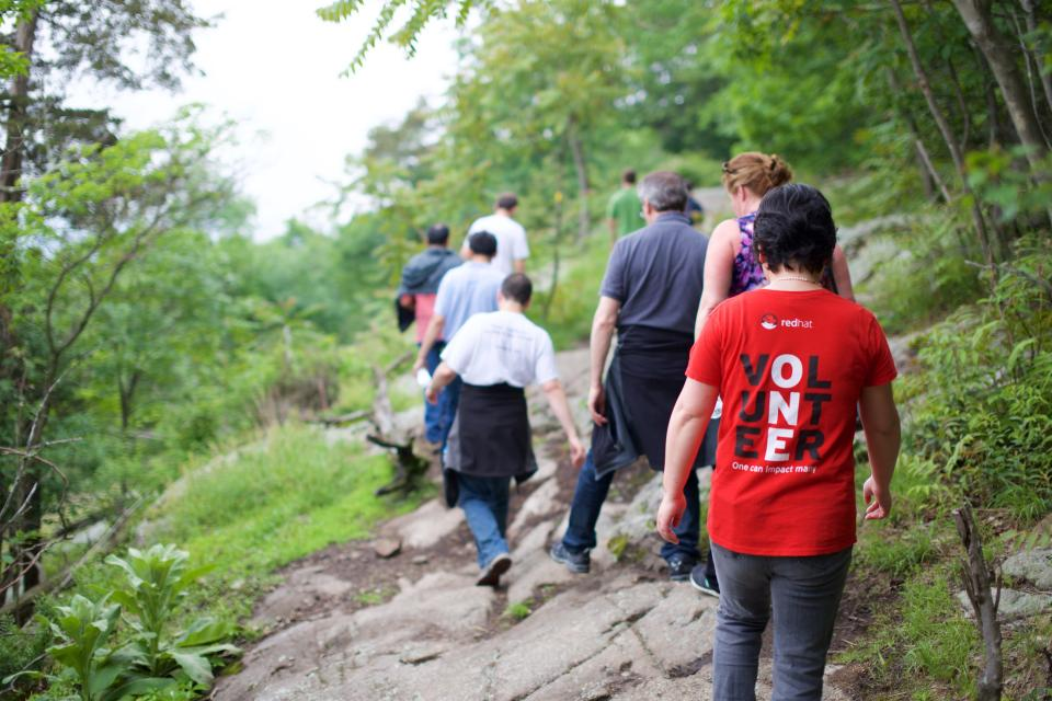 Red Hatters love to volunteer together and give back to their communities.