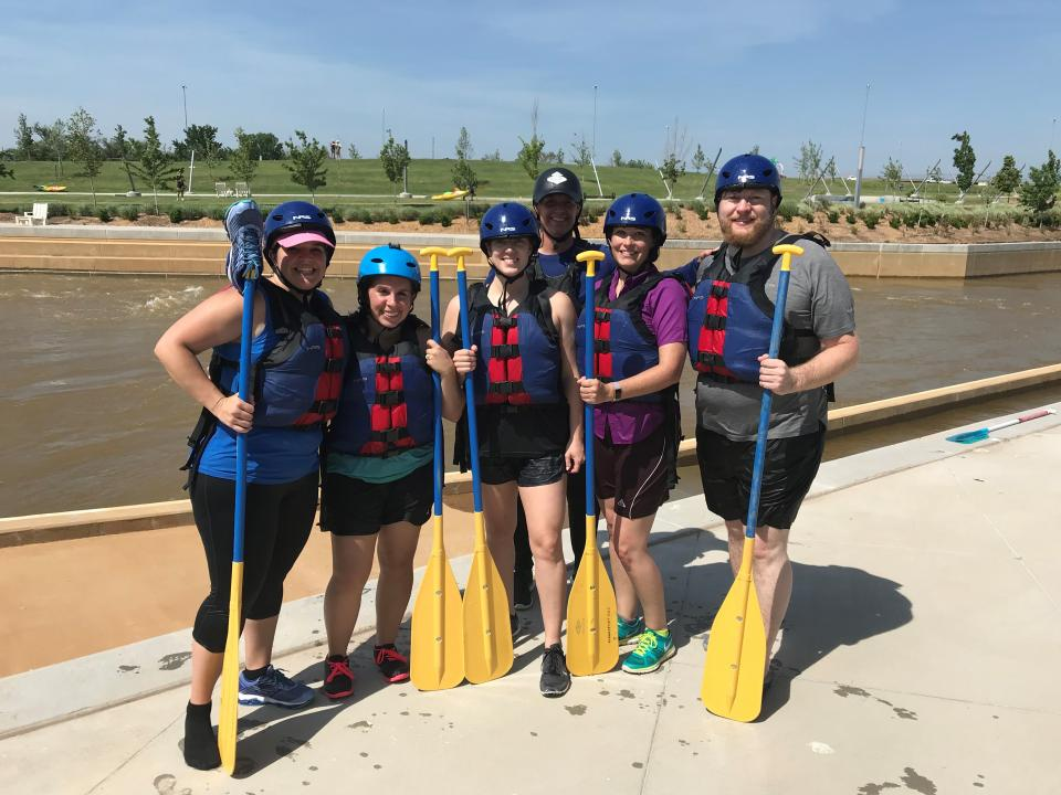 Employees participating in water rafting