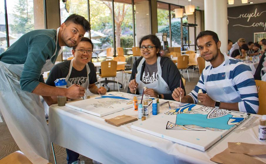 Working together on an artwork project to help create more welcoming hospital spaces is just one of the many service opportunities available during Month of Service.