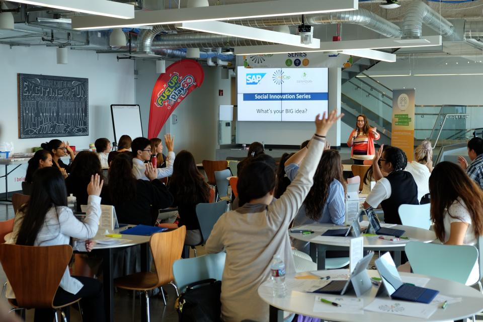 SAP mentor, Kate Morgan, leads a Social Innovation workshop with a group of excited youth who are eager to participate