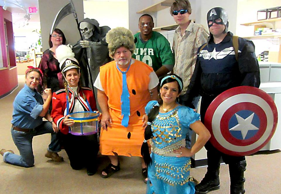Our St. Louis office employees enjoying their costumes!