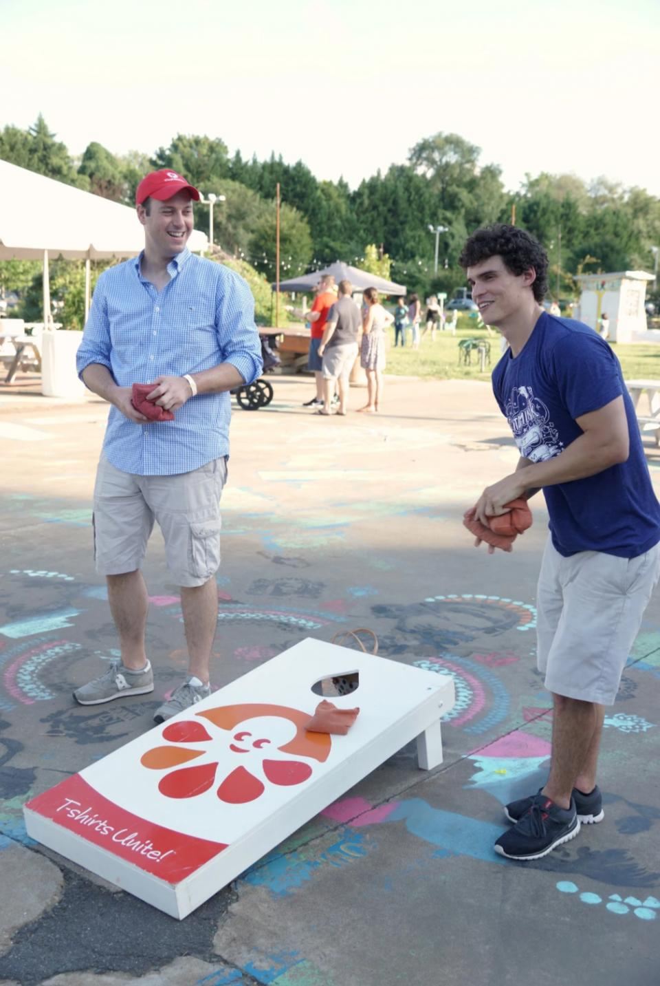 Marc plays cornhole with Inkers at the Charlottesville BBQ.