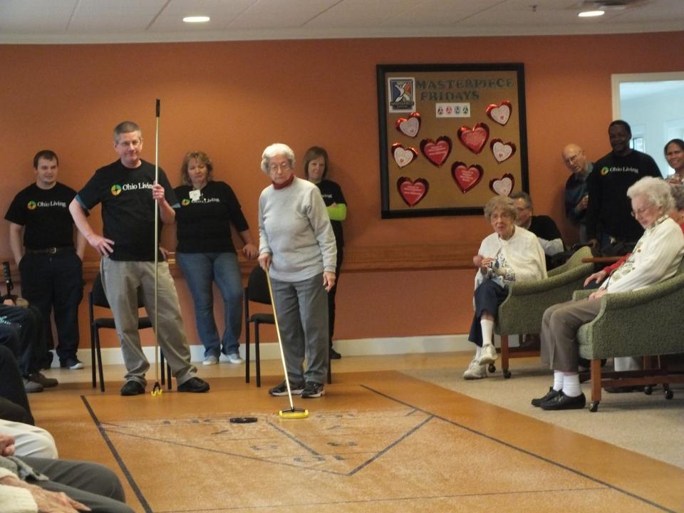 Residents and staff enjoying shuffleboard