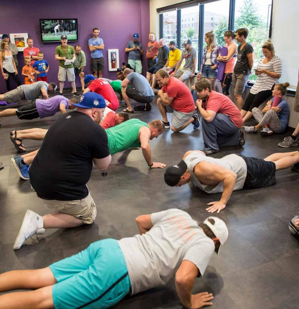 Our annual push-up and plank competition raises money for the family of an employee who passed away.