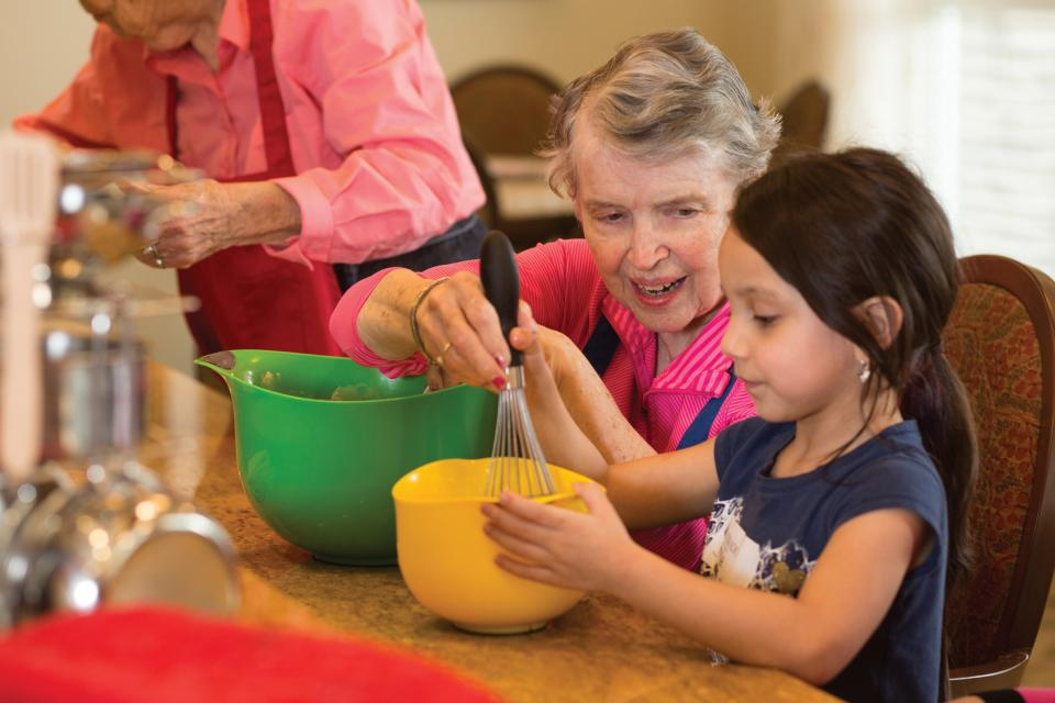 Residents baking with associate's daughter