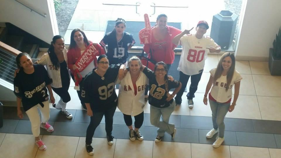 Employees show off their favorite sports teams during Spirit Week.