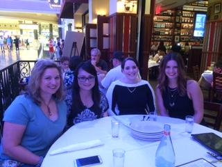 Team members celebrating a colleagues' birthday with a dinner while traveling in Las Vegas