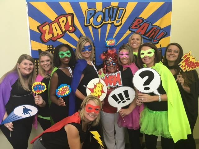 Employees enjoying the selfie station of our Super Hero Breakfast celebration earlier this year.