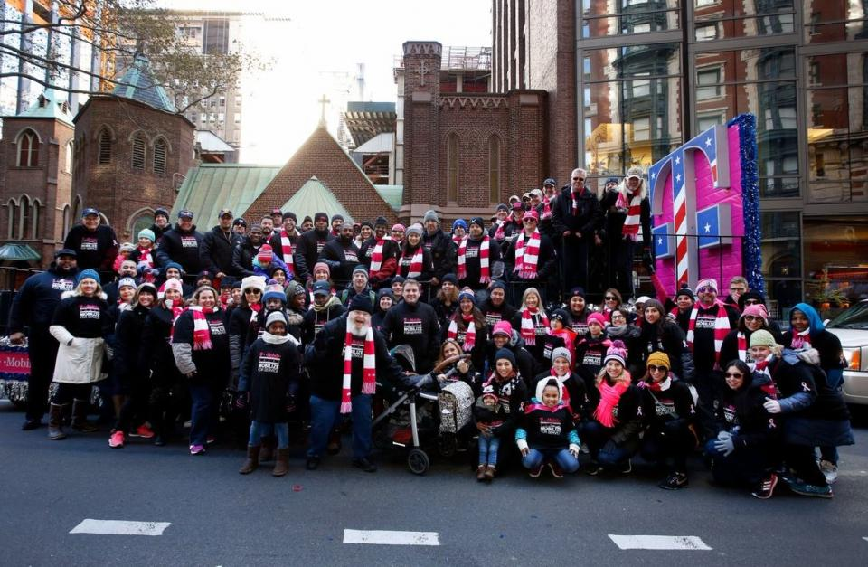 T-Mobile employees march in the annual Veterans Day Parade