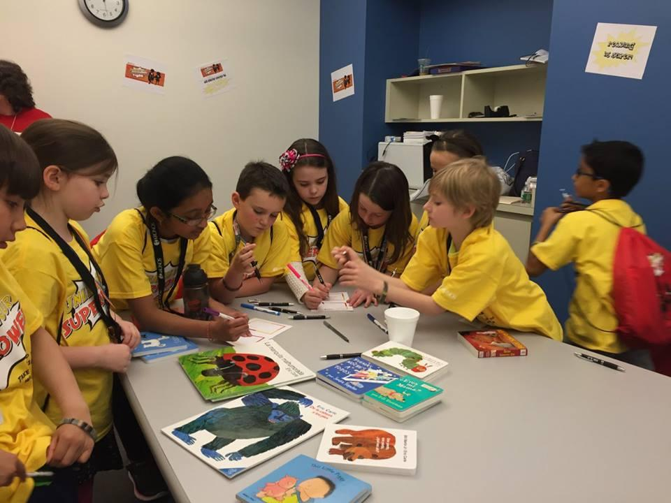 Kronite children work together on a project to give back to the communities where we live and work at our annual Take Your Child to Work Day.