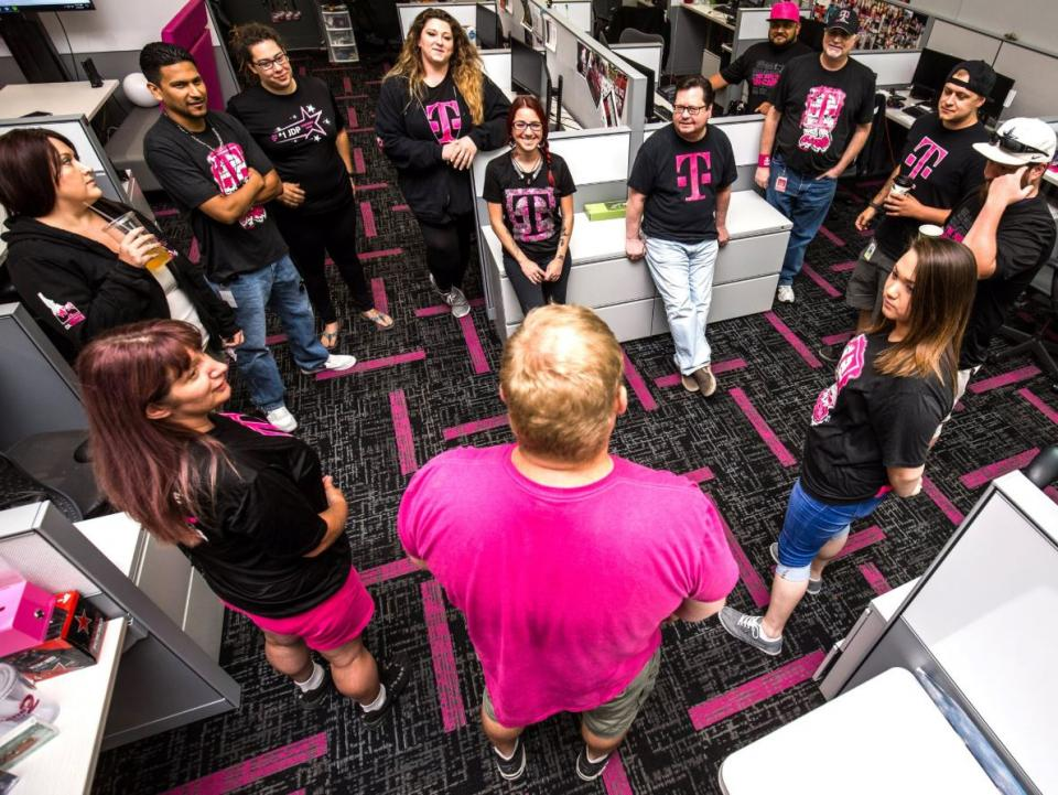 Team of Expert employees huddle at a T-Mobile call center