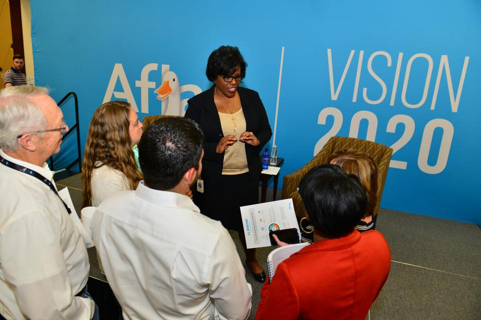 Aflac U.S. President Teresa White explains the details of Aflac's corporate strategy during a town hall meeting.