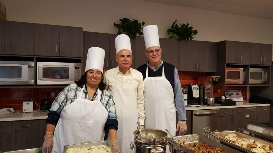 Members of our executive committee give back to employees by serving Thanksgiving lunch.