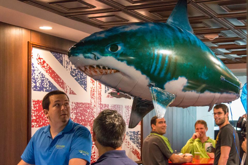 Flying a shark balloon in British café