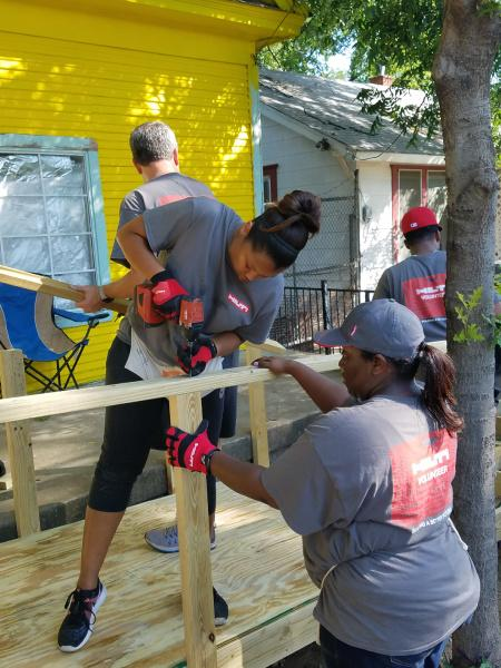 Team Members volunteer to build a wheelchair ramp for a local non-profit. Each Hilti employee receives paid days to volunteer. Team members can choose to contribute on their own or as a team.